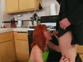 Redheaded milf has her unshaved snatch screwed on