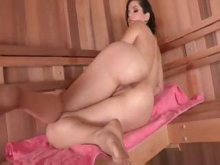 Brunette babe, Bobbi Starr gets caught playing with herself in the sauna and fucks his cock
