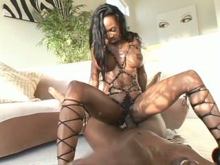 Dark milf with leather straps riding on a huge darksome dick !