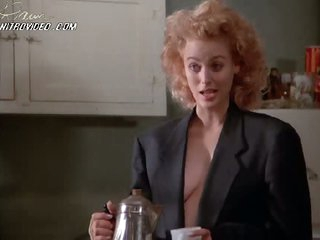 Blond Babe Virginia Madsen Drinking Coffee and Showing Her Cleavage