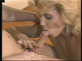 Retro Office Whore Ginger Lynn Receives Fucked and Facialized By Her Boss