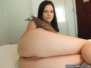 Seductive Brandi Belle putting on a hot and sexy show while in couch