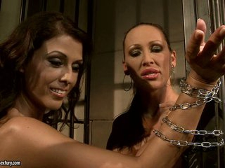 Mandy Bright chained a hot babe at the jail metallic