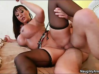 Experienced exotic middle aged woman Ava Devine with huge tits is so sexy. She seduces her son's friend and enjoys his hard young dick in her experienced asshole. She enjoys anal sex with her stockings and high heels on.