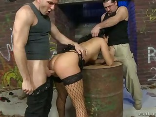 Dark haired sexy bitch Bettina DiCapri in black fishnet stockings gets fucked by several men at once. Two hard pulsating cocks are more than enough for this horny brunette babe.