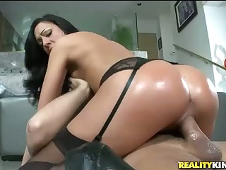 Big round ass of curvy brunette Tiffany Brookes is a real masterpiece. She wears black stockings with garter belt. It makes her perfect big booty look even better. Lucky guy Voodoo gets his long cock sucked by this sexiest lady before she rides him keepin
