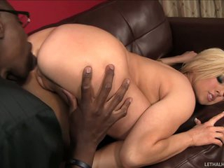 Christie Stevens is a super sexy flexible blonde that does the splits in front of black guy and then takes off her panties. He licks her pussy and ass before pulling out his massive dick.