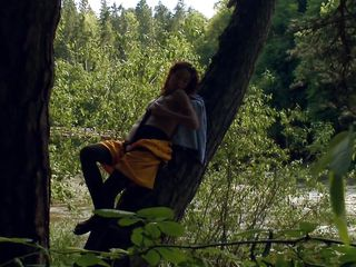 adventurous babe enjoying her masturbation on a tree