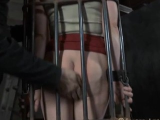 Dirty slave in the cage looks inauspicious while she is treated badly