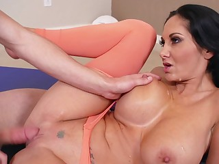 A milf that has a sexy round ass is getting fucked by her man