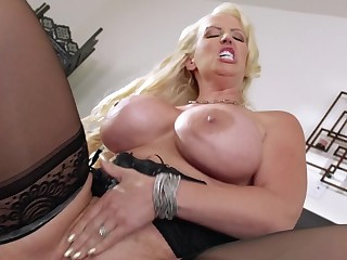 A blonde that has huge tits is getting penetrate don the bed