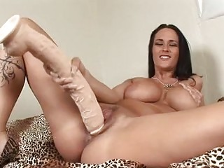 Heavy chested brunette sticks monster sex-toy up her shaved taco