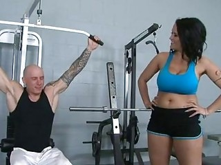 Darksome haired pornstar with giant puppies gets banged in gym