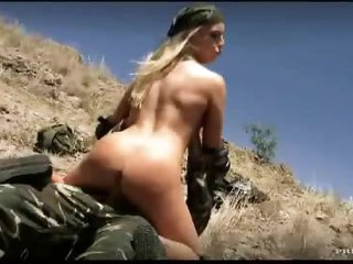 Camo raiment on anal couple outdoors