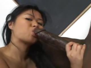 Pierced Asian love tunnel screwed by big black cock