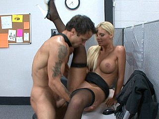 Blondie in stockings acquires fucked by coworker