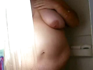 Overweight amateur films her shower